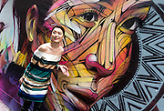 """Wall painting by Parisian street artist Alexandre Monteiro aka Hopare of Hong Kong actress and canto pop star Niki Chow (pictured)<br /> """"Walls of Change"""" street art in Hong Kong ahead of the The """"Hope for Wildlife"""" Gala Dinner painted to raise awareness for the plight of endangered animals the world over.<br /> Sai Yin Pun Hong Kong<br /> 10th November 2016. Photo by Jayne Russell"""