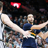 02 April 2017: Utah Jazz center Rudy Gobert (27) looks to pass the ball over San Antonio Spurs center Pau Gasol (16) during the San Antonio Spurs 109-103 victory over the Utah Jazz, at the AT&T Center, San Antonio, Texas, USA.