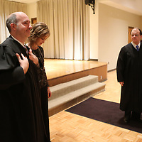 Bradley Tennison, left, tries on his Judges robe after he is sworn in for Chancery Judge in Booneville Friday morning.