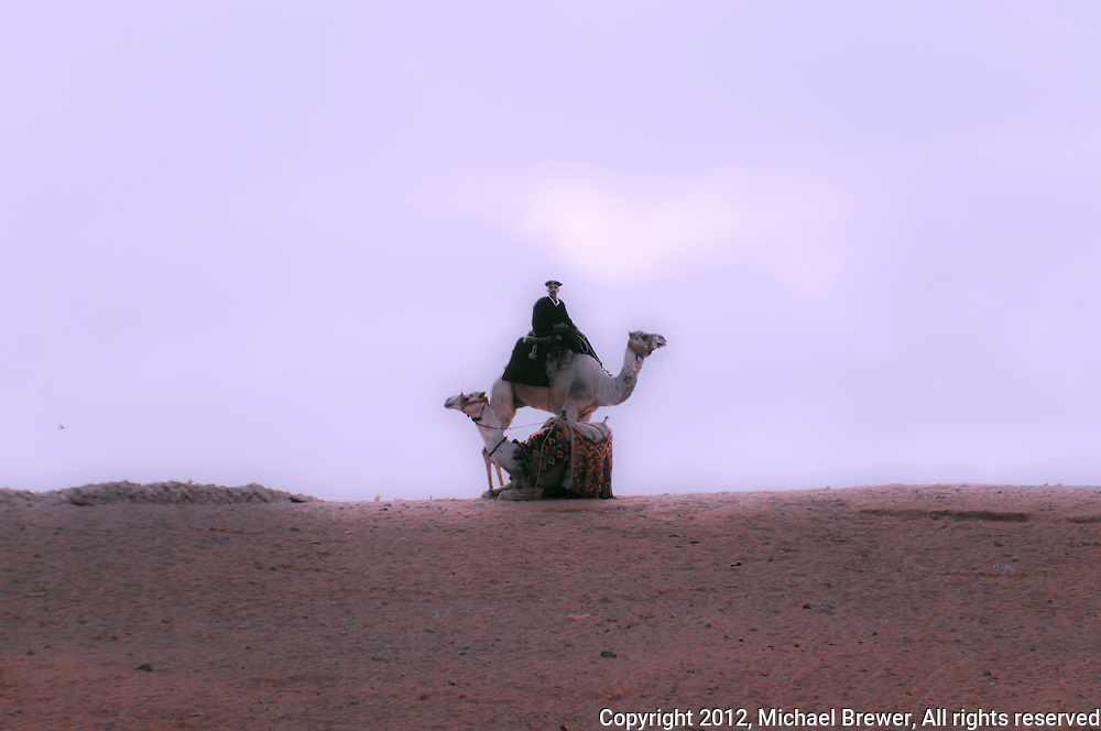 Mounted policeman on a camel in Giza, Egypt.