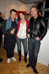 Left to right, actor JONNY LEE MILLER, YASMIN MILLS and SIMON MILLS at an exhibition of artist Natasha Law's work entitled 'Room' hosted by the Eleven gallery in association with Ruinart champagne at 121 Charing Cross Road, London WC2 on 16th January 2008.  Following the private view a dinner was held at Soho House hosted by Ruinart.<br /> <br />  (EMBARGOED FOR PUBLICATION IN UK MAGAZINES UNTIL 1 MONTH AFTER CREATE DATE AND TIME) www.donfeatures.com  +44 (0) 7092 235465