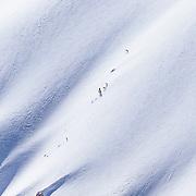 Owen Leeper skis a monster line in the Teton backcountry.