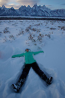 Jessica Laman (age 9) makes a snow angel below the Tetons.<br />