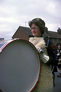 Woman playing a big bass drum at a GLB (Girls Life Brigade) parade, Stowmarket, UK, 1963