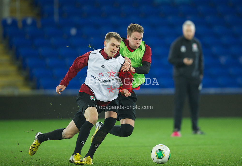 CARDIFF, WALES - Monday, March 18, 2013: Wales' Aaron Ramsey and Chris Gunter during a training session at the Cardiff City Stadium ahead of the 2014 FIFA World Cup Brazil Qualifying Group A match against Scotland. (Pic by David Rawcliffe/Propaganda)