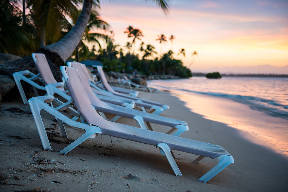 Empty beach chairs at sunset on Coco Beach, Río Grande, Puerto Rico