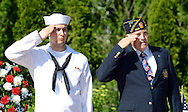 IVYLAND, PA - MAY 26:  Corey Carver (L) of Southampton, Pennsylvania and Ed Oldroyd of Ivyland, Pennsylvania salute during the playing of TAPS during the Ivyland Memorial Day Parade and Ceremony May 26, 2014 in Ivyland, Pennsylvania. (Photo by William Thomas Cain/Cain Images)