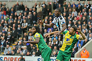 Newcastle United defender Chancel Mbemba  climbs highest  during the Barclays Premier League match between Newcastle United and Norwich City at St. James's Park, Newcastle, England on 18 October 2015. Photo by Simon Davies.