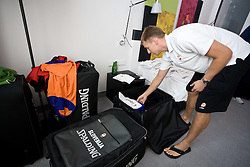 Matjaz Vezjak preparing jerseys and towels for Erazem Lorbek (15) of Slovenia in a Andel's Hotel during Eurobasket 2009, on September 15, 2009 in  Lodz, Poland.  (Photo by Vid Ponikvar / Sportida)