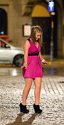 © Licensed to London News Pictures. FILE PICTURE DATED 01/01/2012. New Years Day revellers in Manchester. A young lady struggles to keep her balance on the cobbles in front of Manchester's Town Hall. Please see special instructions for usage rates. Photo credit should read Joel Goodman/LNP