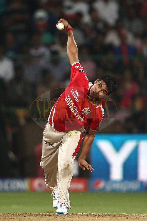 Karanveer Singh of the Kings XI Punjab sends down a delivery during the final match of the Pepsi Indian Premier League Season 2014 between the Kings Xi Punjab and the Kolkata Knight Riders held at the M. Chinnaswamy Stadium, Bangalore, India on the 1st June  2014<br /> <br /> Photo by Shaun Roy / IPL / SPORTZPICS<br /> <br /> <br /> <br /> Image use subject to terms and conditions which can be found here:  http://sportzpics.photoshelter.com/gallery/Pepsi-IPL-Image-terms-and-conditions/G00004VW1IVJ.gB0/C0000TScjhBM6ikg