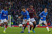 Connor Goldson of Rangers FC shields the ball from Uche Ikpeazu of Hearts during the Betfred Scottish League Cup semi-final match between Rangers and Heart of Midlothian at Hampden Park, Glasgow, United Kingdom on 3 November 2019.