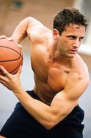 A young man playing basketball.