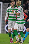 Celtic's Ryan Christie (#17) & Moritz Bauer (#13) celebrate following their goal during the Europa League match between Celtic and Rennes at Celtic Park, Glasgow, Scotland on 28 November 2019.