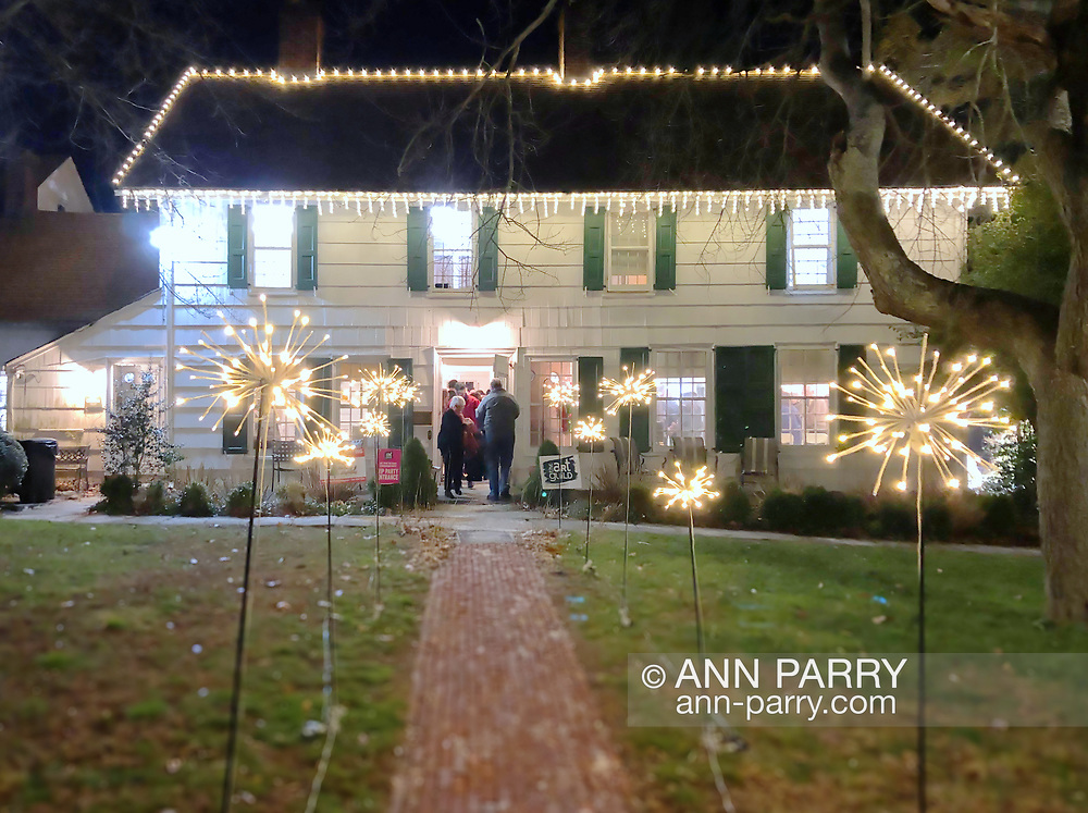 December 7, 2019. Manhasset, New York, U.S. Guests enter historic house, with festive outdoor lights, at Elderfields Preserve during The Art Guild's annual 10x10 Fundraiser Silent Auction and Reception. Manhasset, NY, U.S., Dec.7, 2019. Guests enter historic house at Elderfields Preserve during The Art Guild's annual 10x10 Silent Auction Fundraiser and Reception.