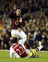 Photo: Chris Ratcliffe.<br />Arsenal v Ajax. UEFA Champions League. 07/12/2005.<br />Robin Van Persie skpis over Juanfran