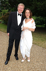 DAVID 'KID' JENSON and his wife GUDRUN at a fund raising event for The Galapagos Conservation Trust entitled 'Some Enchanted Evening' at the Chelsea Physic Garden Chelsea, London on 17th June 2004.