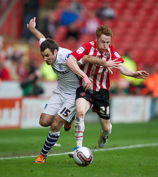 SHEFFIELD, ENGLAND - Saturday, March 17, 2012: Tranmere Rovers' Danny Holmes in action against Sheffield United's Stephen Quinn during the Football League One match at Bramall Lane. (Pic by David Rawcliffe/Propaganda)