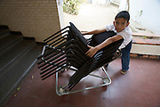 "Boy with chairs. Jose? Marti? Bolivarian school at the Barrio Sarria, one of Caracas' poor quarters, is home to the ""Nucleo Sarria of the ""Fundacion del Estado para el Sistema Nacional de las Orquestas Juveniles e Infantiles de Venezuela"" (FESNOJIV, National Network of Youth and Children Orchestras of Venezuela). This organization is also known as El Sistema, is a publicly financed private-sector music-education program in Venezuela, originally called Social Action for Music, founded 1975 by Venezuelan economist and amateur musician Jose? Antonio Abreu."