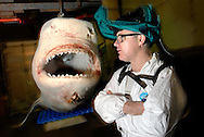 Damien Hirst's 'The Physical Impossibility of Death in the Mind of Someone Living (1991)', his infamous tiger shark in a glass tank of formaldehyde, is being restored by  his 'crew' and experts from The Natural History Museum in London. Chemical suits and masks are used to protect against the formaldehyde being injected in to the shark. Photo shows Damien Hirst with spare frozen shark.
