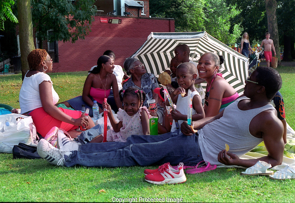 Family picnic in Battersea Park, South London.