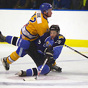 Southern Stampede player Braden Lee (yellow shirt) tangles with  West Auckland Admiral player Florian Meier during the Southern Stampede V West Auckland Admirals New Zealand Ice Hockey League match at the Queenstown Ice Arena, Queenstown, South Island, New Zealand, 4th June 2011