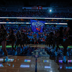 Jan 28, 2018; New Orleans, LA, USA; New Orleans Pelicans mascot Pierre the Pelican waves a flag as the Pelicans dance team performs during introductions before a game against the LA Clippers at the Smoothie King Center. Mandatory Credit: Derick E. Hingle-USA TODAY Sports