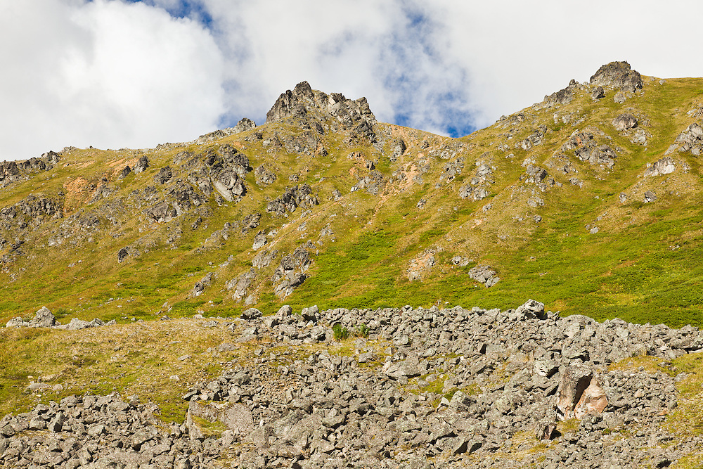 Boulder fields abound among the Talkeetna Mountains at Summit Lake State Recreation Site in Hatcher Pass in Southcentral Alaska. Summer. Morning.
