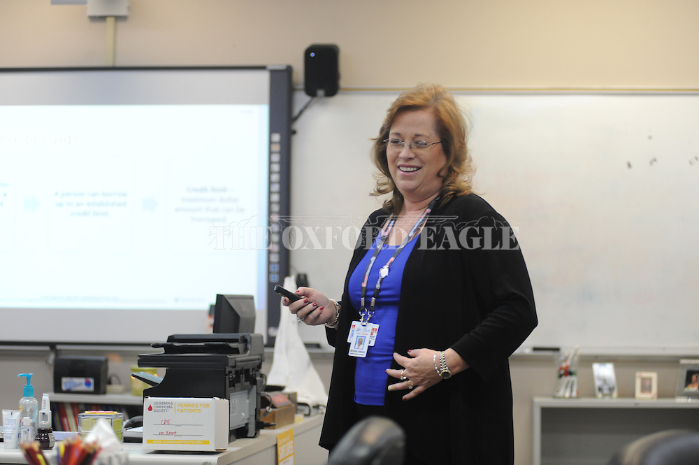 Beverly Brent, a DECA instructor at the Oxford-Lafayette School of Applied Technology, teaches a class in Oxford, Miss. on Friday, February 6, 2015. Brent is one of eight teachers in the area who have recently become Nationally Board Certified Teachers.