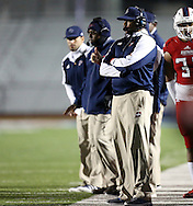 Bishop Dunne coaches watch from the sidelines during the TAPPS Division I state championship game on Saturday, Dec. 3, 2016 at Panther Stadium in Hewitt, Texas. Bishop Lynch High School won 21-17. (Photo by Kevin Bartram)