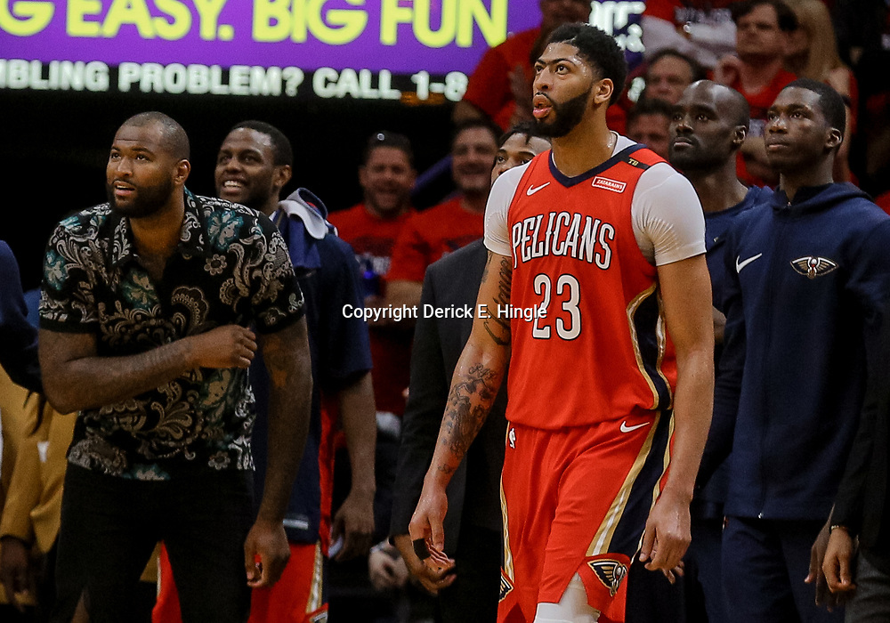 Apr 19, 2018; New Orleans, LA, USA; New Orleans Pelicans center DeMarcus Cousins (left) reacts from the bench as forward Anthony Davis (23) looks on during the second quarter in game three of the first round of the 2018 NBA Playoffs against the Portland Trail Blazers at the Smoothie King Center. Mandatory Credit: Derick E. Hingle-USA TODAY Sports