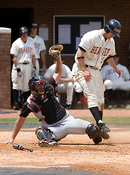 Oregon State Beavers IF Lonnie Lechelt (15) collides with Rutgers Scarlett Knights C Frank Meade (29).  The Oregon State Beavers defeated the Rutgers Scarlet Knights 5-2 in Game 5 of the NCAA World Series Charlottesville Regional held at Davenport Field in Charlottesville, VA on June 4, 2007.