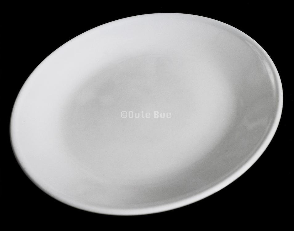 White plate against black background