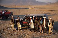 "Afghanistan. Kandahar. Talibans, Herat police, in Kishad Djali cemetery were are buried the talibans killed in Mazar  Kandahar/ /  Talibans; la police de Herat, dans le Cimetiere  des martyrs ""Kishad Djalil "". Des talibans prient pour leurs freres massacres a Mazar I Shariff.   Kandahar/   Afghanistan ,"