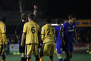 referee Christopher Sarginson shows AFC Wimbledon defender Paul Robinson (6) the Red Card during the The FA Cup third round replay match between AFC Wimbledon and Sutton United at the Cherry Red Records Stadium, Kingston, England on 17 January 2017. Photo by Stuart Butcher.