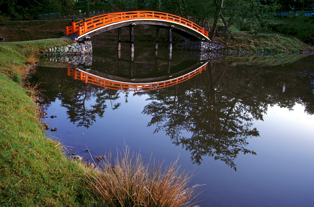 The beautiful Royal Bridge is reflected in glassy waters in Nara, Japan.