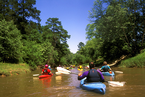 Stock photo of a group kayaking down a river