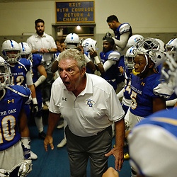 Charter Oak head coach Lou Farrar fires up his team prior to a prep football game against Colony at Charter Oak High School in Covina, Calif., on Friday, Sept. 2, 2016.