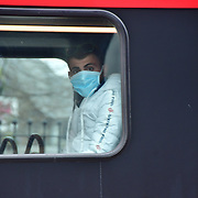 During the coronavirus in UK lockdown seen a young man wearing a mask on the bus, at Walthamstow Square,on 28 March 2020 London.