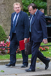Downing Street, London, June 16th 2015. David Mundell, Secretary of State for Scotland (L) arrives at 10 Downing Street for the weekly cabinet meeting, accompanied by John Whittingdale, Secretary of State for Culture, Media and Sport.