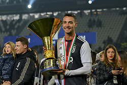 May 19, 2019 - Turin, Turin, Italy - Mattia De Sciglio of Juventus FC lifts the trophy of Scudetto  2018-2019 at Allianz Stadium, Turin  (Credit Image: © Antonio Polia/Pacific Press via ZUMA Wire)