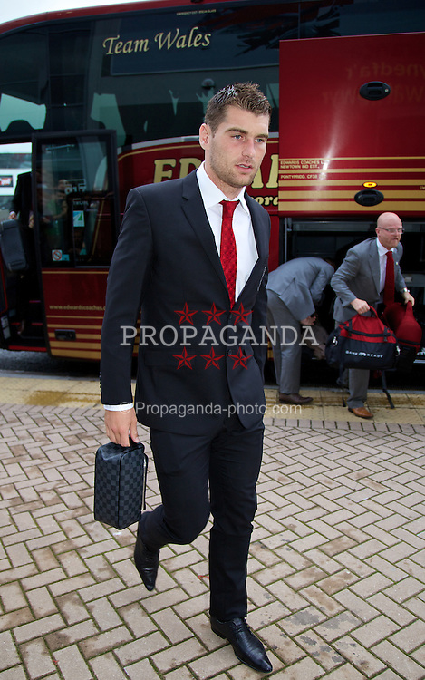 CARDIFF, WALES - Wednesday, August 14, 2013: Wales' Sam Vokes arrives for the International Friendly against Republic of Ireland at the Cardiff City Stadium. (Pic by David Rawcliffe/Propaganda)