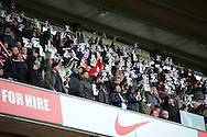 Charlton Athletic fans hold up 2% cards 2 minutes into the game in protest about owner Roland Duchatelet saying only 2% of the fans are unhappy during the Sky Bet Championship match at The Valley, London<br /> Picture by Alan Stanford/Focus Images Ltd +44 7915 056117<br /> 28/11/2015