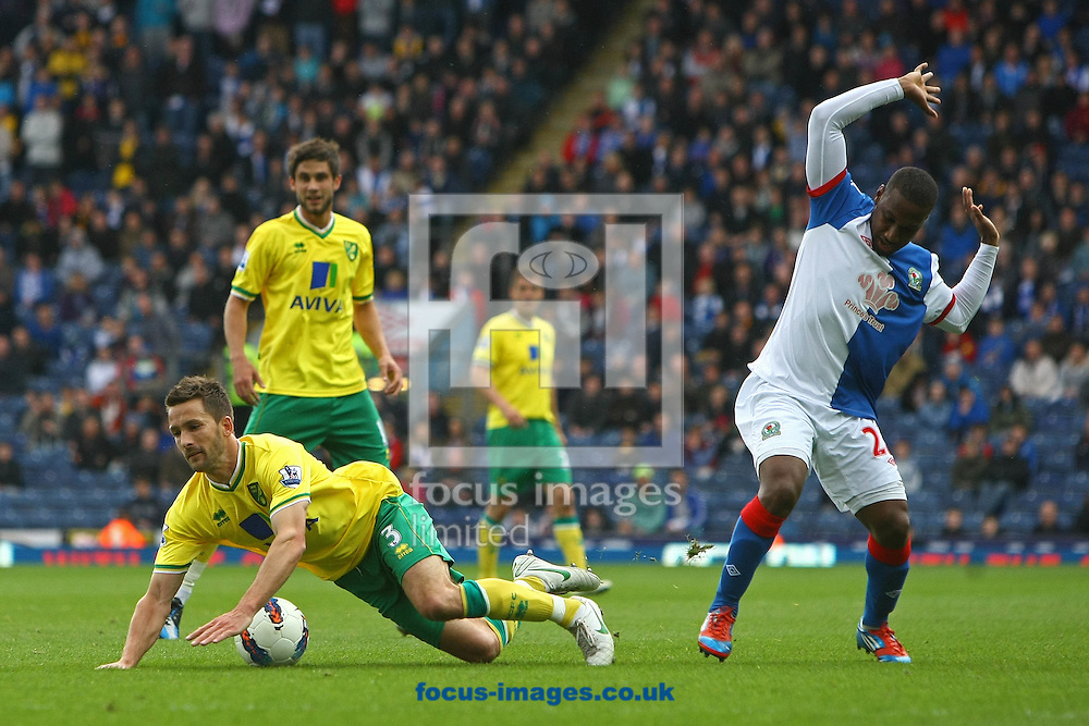 Picture by Paul Chesterton/Focus Images Ltd.  07904 640267.21/04/12.Adam Drury of Norwich and Junior Hoilett of Blackburn in action during the Barclays Premier League match at Ewood Park Stadium, Blackburn