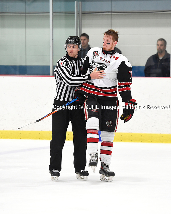 GEORGETOWN, ON - APR 18,  2017: Ontario Junior Hockey League, Championship Series. Georgetown Raiders vs the Trenton Golden Hawks in Game 3 of the Buckland Cup Final.  OHA Linesman Scott Walker separates Jonathan Hampton #71 of the Georgetown Raiders from an incident during the third period.<br /> (Photo by Andy Corneau / OJHL Images)