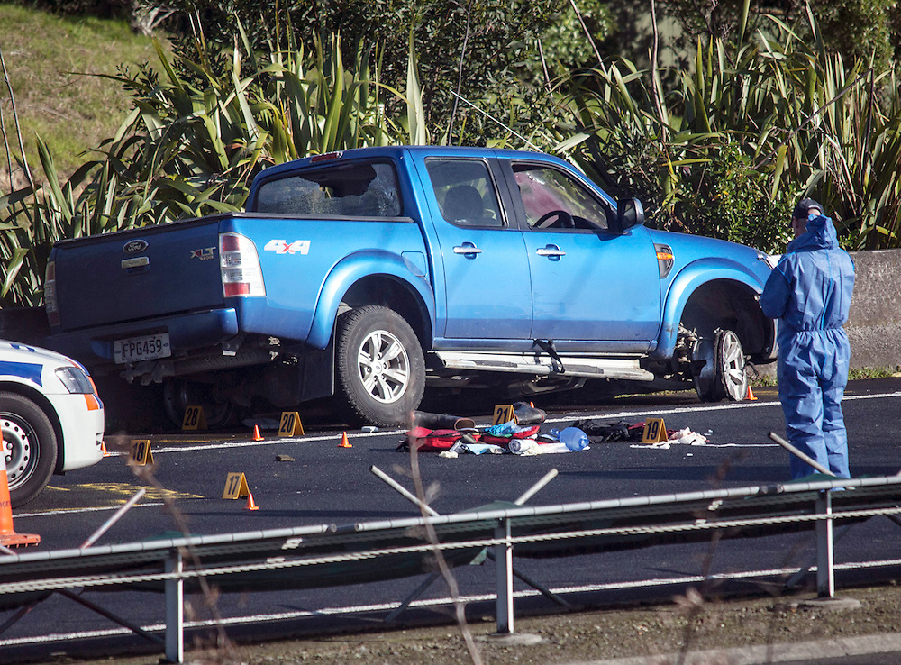 Blood splatter can be seen on the ute window at the scene on Aucklands Northern Motorway where an alleged offender died after exchanging shots with police following a dramatic car chase from Opotiki, Auckland, New Zealand,  Monday, July 08, 2013. Credit:SNPA / Bradley Ambrose