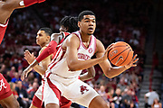 FAYETTEVILLE, AR - MARCH 9:  Mason Jones #13 of the Arkansas Razorbacks makes a pass during a game against the Alabama Crimson Tide at Bud Walton Arena on March 9, 2019 in Fayetteville, Arkansas.  The Razorbacks defeated the Crimson Tide 82-70.  (Photo by Wesley Hitt/Getty Images) *** Local Caption *** Mason Jones