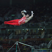 Gymnastics - Olympics: Day 3    Kristian Thomas #137 of Great Britain performing his Horizontal Bar routine during the Artistic Gymnastics Men's Team Final at the Rio Olympic Arena on August 8, 2016 in Rio de Janeiro, Brazil. (Photo by Tim Clayton/Corbis via Getty Images)