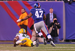 Dec 4, 2011; East Rutherford, NJ, USA; New York Giants tight end Travis Beckum (47) eludes a tackle by Green Bay Packers free safety Morgan Burnett (42) after catching a pass from New York Giants quarterback Eli Manning (10) during the first half at MetLife Stadium.