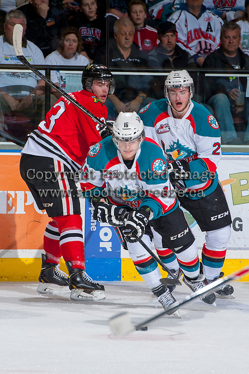 KELOWNA, CANADA - APRIL 18: Kris Schmidli #16 of the Kelowna Rockets skates with the puck against the Portland Winterhawks on April 18, 2014 during Game 1 of the third round of WHL Playoffs at Prospera Place in Kelowna, British Columbia, Canada.   (Photo by Marissa Baecker/Shoot the Breeze)  *** Local Caption *** Kris Schmidli;